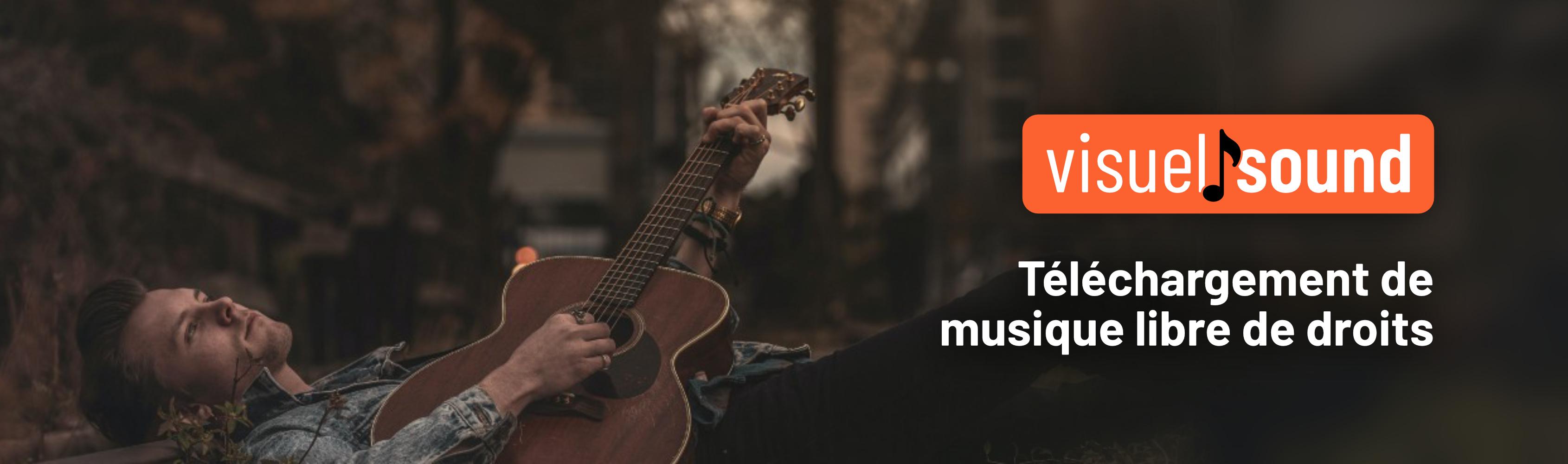 Third slide, un guitariste folk joue allongé sur ligne de train abondonné avec un message indique Téléchargement de musique libre de droit